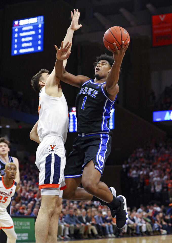 Duke center Vernon Carey Jr. (1) shoots next to Virginia center Francisco Caffaro (22) during an NCAA college basketball game Saturday, Feb. 29, 2020, in Charlottesville, Va. (AP Photo/Andrew Shurtleff)