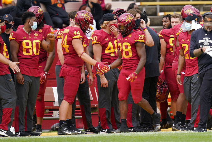Iowa State running back Breece Hall (28) celebrates with teammates after scoring a touchdown during the first half of an NCAA college football game against Louisiana-Lafayette, Saturday, Sept. 12, 2020, in Ames, Iowa. (AP Photo/Charlie Neibergall)