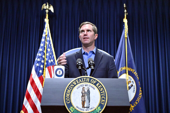 Kentucky Gov. Andy Beshear speaks about the increases in COVID-19 cases in the state and the opening day of the Kentucky State Legislature special session in Frankfort, Ky., Tuesday, Sept. 7, 2021. (AP Photo/Timothy D. Easley)