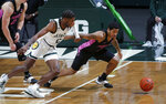 Penn State's Sam Sessoms, right, and Michigan State's Aaron Henry chase the ball during the first half of an NCAA college basketball game, Tuesday, Feb. 9, 2021, in East Lansing, Mich. (AP Photo/Al Goldis)