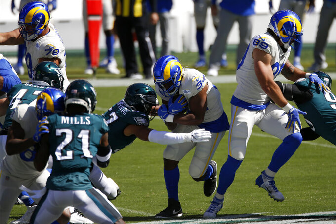 Los Angeles Rams' Malcolm Brown rushes against Philadelphia Eagles' T.J. Edwards during the first half of an NFL football game, Sunday, Sept. 20, 2020, in Philadelphia. (AP Photo/Laurence Kesterson)