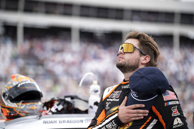 NASCAR Xfinity Series driver Noah Gragson (9) stands during the national anthem prior to the NASCAR Xfinity auto race at the Charlotte Motor Speedway Saturday, Oct. 9, 2021, in Concord, N.C. (AP Photo/Matt Kelley)