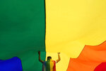 A participant holds up a large rainbow flag during the annual LGBT pride march in Belgrade, Serbia, Saturday, Sept. 18, 2021. (AP Photo/Darko Vojinovic)