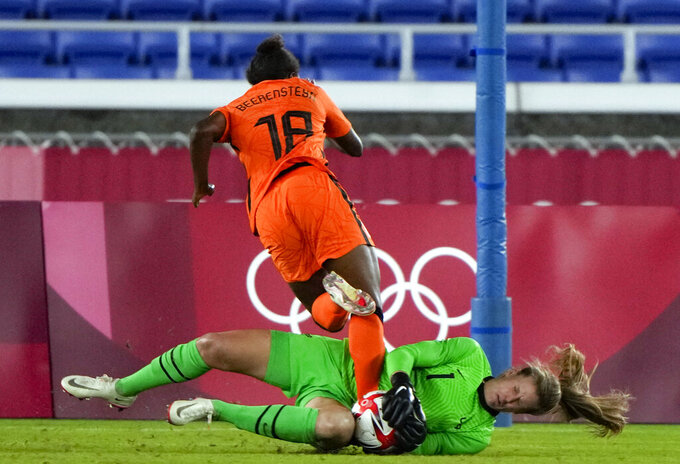 United States' goalkeeper Alyssa Naeher catches the ball as Netherlands' Lineth Beerensteyn challenges her during a women's quarterfinal soccer match at the 2020 Summer Olympics, Friday, July 30, 2021, in Yokohama, Japan. (AP Photo/Kiichiro Sato)