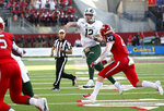 Colorado State quarterback Patrick O'Brien (12) passes past Fresno State linebacker Justin Rice (29) during the first half of an NCAA college football game in Fresno, Calif., Saturday, Oct. 26 2019. (AP Photo/Gary Kazanjian)