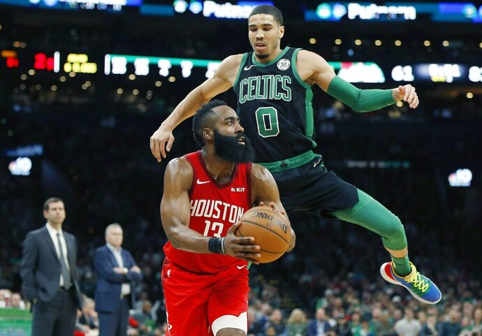 Houston Rockets' James Harden (13) prepares to shoot from three-point territory as Boston Celtics' Jayson Tatum (0) defends during the second half of an NBA basketball game in Boston, Sunday, March 3, 2019. (AP Photo/Michael Dwyer)