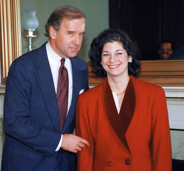 FILE - In this Jan. 6, 1993, file photo, Attorney General-designate Zoe Baird meets with Sen. Joseph Biden (D-Del.), chairman of the Senate Judiciary Committee, on Capitol Hill in Washington. This image has circulated widely on social media in early May 2020 with false claims that it shows Democratic presidential candidate Biden posing with Tara Reade, a former Senate staffer who alleges he assaulted her 27 years earlier. (AP Photo/Ron Edmonds, File)