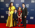 Former NASCAR driver Jeff Gordon, right, and his family from left: Ingrid Vandebosch, son Leo Benjamin and daughter Ella Sofia pose for photos before the NASCAR Hall of Fame induction ceremony for the Class of 2019, Friday, Feb. 1, 2019, in Charlotte, N.C. (AP Photo/Jason E. Miczek)