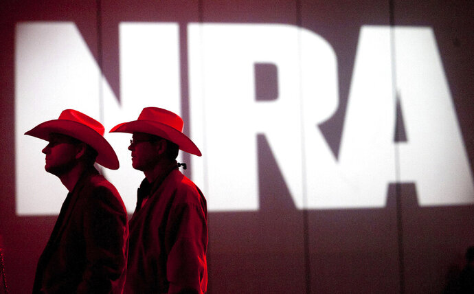 FILE - In this May 4, 2013, file photo, National Rifle Association members listen to speakers during the NRA's annual Meetings and Exhibits at the George R. Brown Convention Center in Houston. The Los Angeles City Council, Tuesday, Jan. 21, 2020 repealed a law requiring companies that want city contracts to disclose whether they have ties to the NRA. The 12-0 vote comes weeks after a judge blocked the city from enforcing the ordinance.(Johnny Hanson/Houston Chronicle via AP, File)