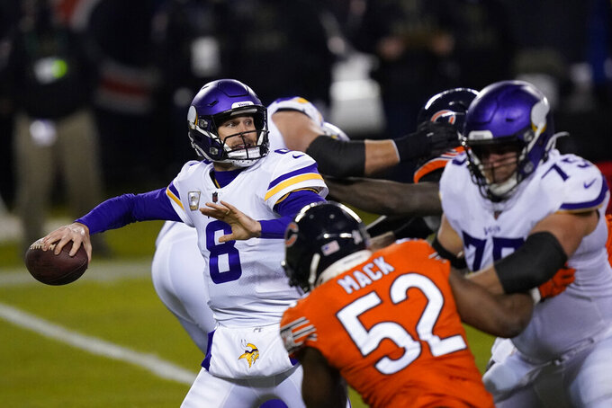Minnesota Vikings quarterback Kirk Cousins throws during the first half of an NFL football game against the Chicago Bears Monday, Nov. 16, 2020, in Chicago. (AP Photo/Charles Rex Arbogast)