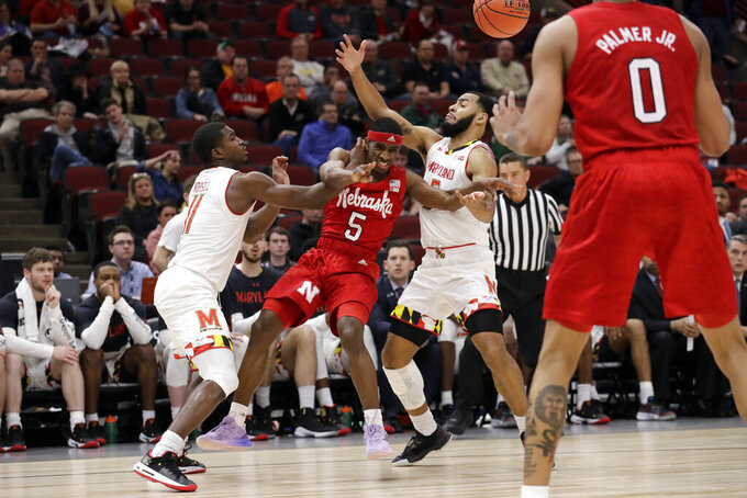 Nebraska's Glynn Watson Jr. (5) passes the ball to James Palmer Jr. (0) against Maryland's Darryl Morsell (11) and Eric Ayala during the second half of an NCAA college basketball game in the second round of the Big Ten Conference tournament, Thursday, March 14, 2019, in Chicago. The Nebraska won 69-61. (AP Photo/Nam Y. Huh)