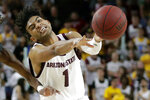 FILE - Arizona State guard Remy Martin (1) passes against Washington State during the second half of an NCAA college basketball game in Tempe, Ariz., in this Saturday, March 7, 2020, file photo. Martin is an AP All-America preseason selection who earned first-team all-Pac-12 notice last year. The 6-foot Martin had 19.1 points and 4.1 assists per game as a junior. (AP Photo/Matt York, File)