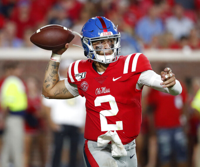 Mississippi quarterback Matt Corral (2) passes against Arkansas during the first half of their NCAA college football game, Saturday, Sept. 7, 2019, in Oxford, Miss. (AP Photo/Rogelio V. Solis)