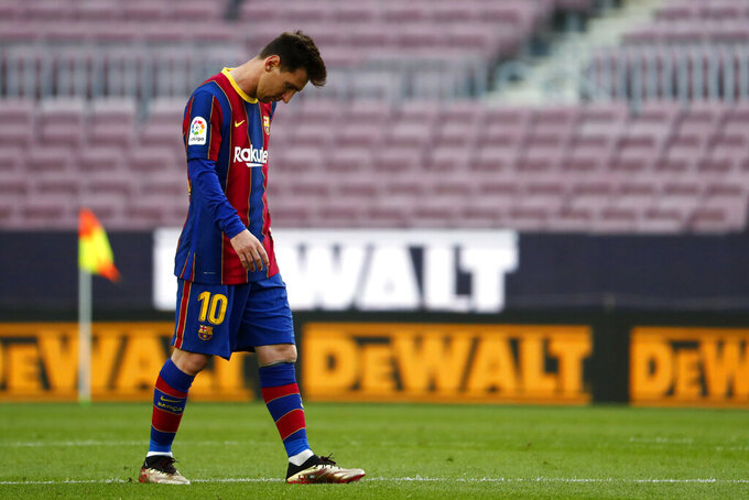 Barcelona's Lionel Messi walks during the Spanish La Liga soccer match between FC Barcelona and Celta at the Camp Nou stadium in Barcelona, Spain, Sunday, May. 16, 2021. (AP Photo/Joan Monfort)