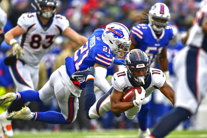 Denver Broncos wide receiver Diontae Spencer (11) is tackled by Buffalo Bills free safety Jordan Poyer (21) during the third quarter of an NFL football game, Sunday, Nov. 24, 2019, in Orchard Park, N.Y. (AP Photo/Adrian Kraus)