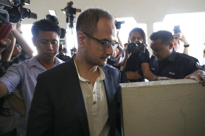 Riza Aziz, stepson of Malaysian former Prime Minister Najib Razak, walks into a court room at Kuala Lumpur High Court in Kuala Lumpur, Malaysia, Friday, July 5, 2019. Malaysia's anti-graft agency said Thursday it has detained Riza Aziz, the stepson of ex-premier Najib Razak and a Hollywood film producer, and will charge him with money laundering. (AP Photo/Vincent Thian)