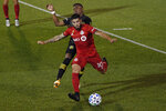 Toronto FC's Alejandro Pozuelo, front is pressured by Columbus Crew's Luis Diaz during the second half of an MLS soccer match, Sunday, Sept. 27, 2020, in East Hartford, Conn. (AP Photo/Jessica Hill)