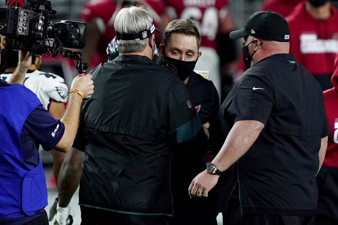 Arizona Cardinals head coach Kliff Kingsbury, right, greets Philadelphia Eagles head coach Doug Pederson an NFL football game, Sunday, Dec. 20, 2020, in Glendale, Ariz. The Cardinals won 33-26. (AP Photo/Rick Scuteri)