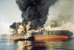 FILE - In this Dec. 6, 1987 file photo, the Singapore-registered tanker Norman Atlantic sits ablaze in the Strait of Hormuz after being attacked by an Iranian gunboat. The U.S. Navy is trying to put together a new coalition of nations to counter what it sees as a renewed maritime threat from Iran. Meanwhile, Iran finds itself backed into a corner and ready for a possible conflict. It stands poised on Friday, Sept. 6, 2019, to further break the terms of its 2015 nuclear deal with world powers. (AP Photo, File)