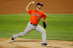 Houston Astros starting pitcher Chase De Jong works against the Texas Rangers during the first inning of a baseball game in Arlington, Texas, Sunday, Sept. 27, 2020. (AP Photo/Roger Steinman)