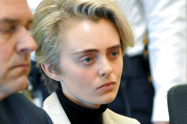 FILE - In this Feb. 11, 2019, file photo, Michelle Carter sits in Taunton District Court for sentencing in Taunton, Mass. Carter, convicted of manslaughter for urging her suicidal boyfriend to kill himself in 2014, is expected to be released sometime, Thursday, Jan. 23, 2020, from the Bristol County jail in Dartmouth, Mass. (Mark Stockwell/The Sun Chronicle via AP, Pool, File)