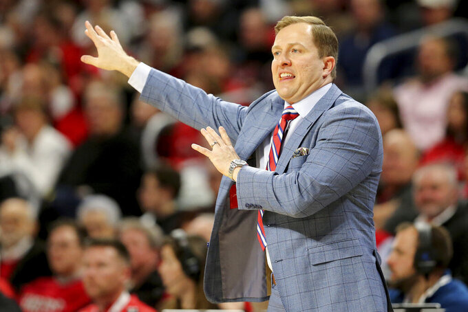 UNLV coach T.J. Otzelberger gestures during the first half of the team's NCAA college basketball game against Cincinnati on Saturday, Nov. 30, 2019, in Cincinnati. (Kareem Elgazzar/The Cincinnati Enquirer via AP)