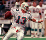 File-This Dec. 24, 1995, file photo shows Miami Dolphins quarterback Dan Marino looking for the downfield receiver against the St. Louis Rams,  in St. Louis. Members of a special panel of 26 selected all of them for the position as part of the NFL's celebration of its 100th season. All won league titles except Marino. All are in the Hall of Fame except Brady and Manning, who are not yet eligible. On Friday, Dec. 27, 2019, quarterback was the final position revealed for the All-Time Team.  (AP Photo/Jane Rudolph, File)