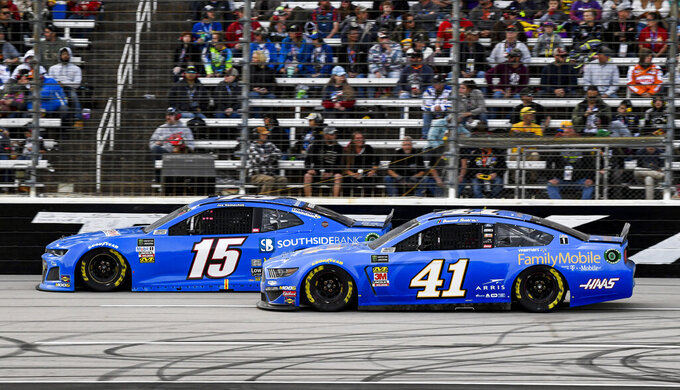 Joe Nemechek (15) and Daniel Suarez (41) battle for position during a NASCAR Cup Series auto race at Texas Motor Speedway, Sunday, Nov. 3, 2019, in Fort Worth, Texas. (AP Photo/Larry Papke)