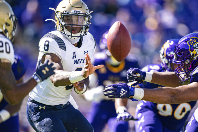 Navy quarterback Dalen Morris (8) pitches the ball running back CJ Williams (20) during an NCAA football game against East Carolina on Saturday, Oct. 17, 2020, in Greenville, N.C. (AP Photo/Jacob Kupferman)