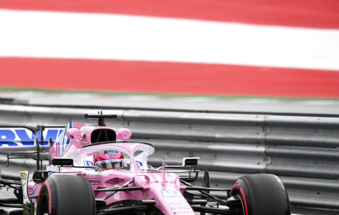 Racing Point driver Sergio Perez of Mexico steers his car during the first practice session at the Red Bull Ring racetrack in Spielberg, Austria, Friday, July 3, 2020. The Austrian Formula One Grand Prix will be held on Sunday. (Joe Klamar/Pool via AP)