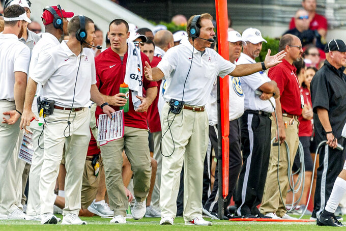 Alabama head coach Nick Saban, center, yells to his players during the second half of an NCAA college football game against New Mexico State, Saturday, Sept. 7, 2019, in Tuscaloosa, Ala. (AP Photo/Vasha Hunt)