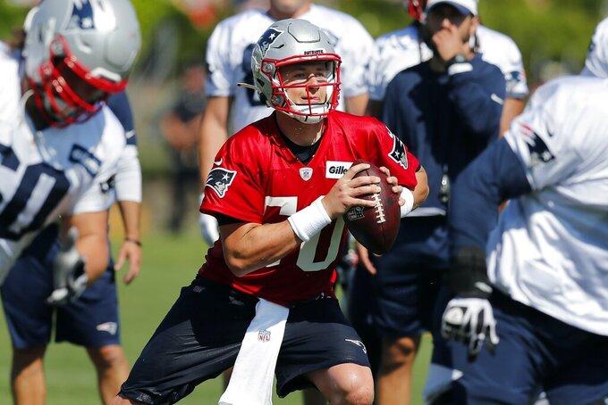 New England Patriots quarterback Mac Jones runs a drill during an NFL football practice, Saturday, July 31, 2021, in Foxborough, Mass. (AP Photo/Michael Dwyer)