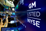 FILE- In this April 23, 2018, file photo, the logo for General Motors appears above a trading post on the floor of the New York Stock Exchange. General Motors Co. reports earns.  General Motors strengthened its pretax profit estimate for 2018 and predicted even stronger performance for 2019 as it executives made a presentation to investors on Friday, Jan. 11, 2019. (AP Photo/Richard Drew, File)