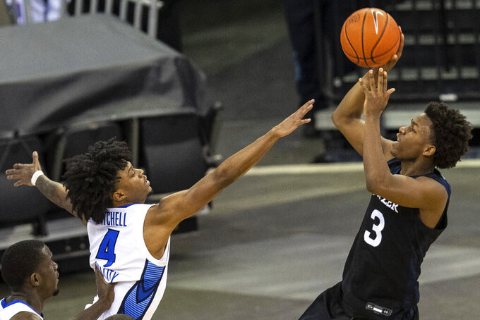 Butler's Chuck Harris shoots over Creighton's Shereef Mitchell during an NCAA college basketball game Saturday, March 6, 2021, in Omaha, Neb. (Chris Machian/Omaha World-Herald via AP)