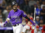 Colorado Rockies left fielder David Dahl (26) walks to the dugout after striking out in the eighth inning of a baseball game against the Philadelphia Phillies in Denver, Saturday, April 20, 2019. Philadelphia won 8-5.(AP Photo/Joe Mahoney)