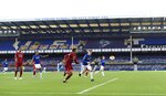 Players play in front of empty stands during the English Premier League soccer match between Everton and Liverpool at Goodison Park in Liverpool, England, Sunday, June 21, 2020. (Peter Powell/Pool via AP)