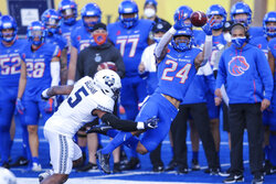 Boise State running back George Holani (24) catches the ball in front of Utah State linebacker Cash Gilliam (5) during the first half of an NCAA college football game Saturday, Oct. 24, 2020, in Boise, Idaho. (AP Photo/Steve Conner)
