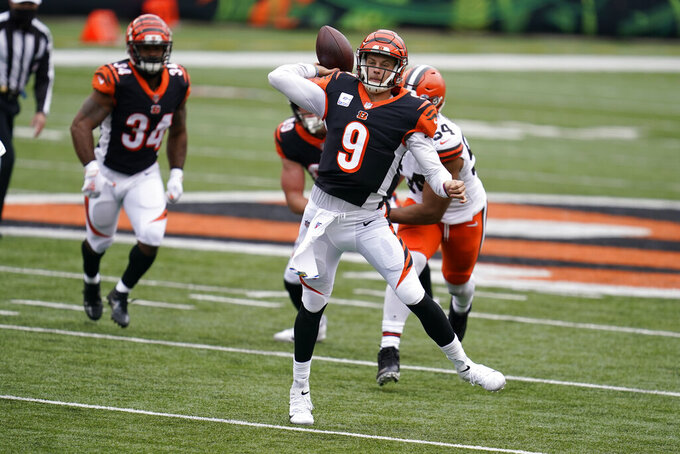 Cincinnati Bengals quarterback Joe Burrow (9) throws during the second half of an NFL football game against the Cleveland Browns, Sunday, Oct. 25, 2020, in Cincinnati. (AP Photo/Michael Conroy)