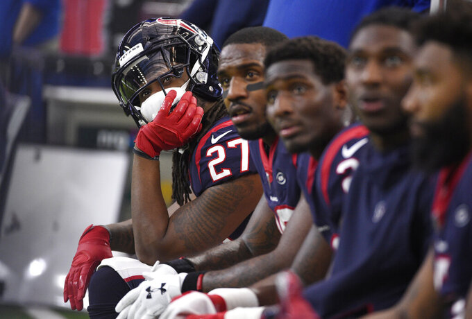 Houston Texans running back D'Onta Foreman (27) sit on the bench with teammates during the first half of an NFL wild card playoff football game against the Indianapolis Colts, Saturday, Jan. 5, 2019, in Houston. (AP Photo/Eric Christian Smith)