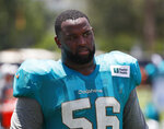FILE - In this July 30, 2019, file photo, Miami Dolphins defensive tackle Davon Godchaux walks off the field after the teams NFL football training camp in Davie, Fla. A person familiar with the deal says the New England Patriots have come to terms with free agent defensive tackle Godchaux on a two-year, $16 million deal with $9 million guaranteed. (AP Photo/Wilfredo Lee, File)