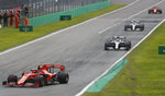 Ferrari driver Charles Leclerc of Monaco, left, leads the two Mercedes of Hamilton and Bottas and Ferrari driver Sebastian Vettel of Germany, during the first laps of the Formula One Italy Grand Prix at the Monza racetrack, in Monza, Italy, Sunday, Sept.8, 2019. (AP Photo/Antonio Calanni)