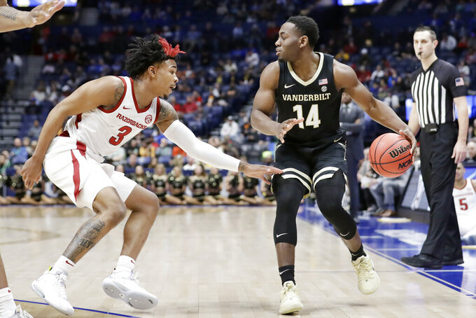 Vanderbilt's Isaiah Rice (14) plays against Arkansas guard Desi Sills (3) in the first half of an NCAA college basketball game in the Southeastern Conference Tournament Wednesday, March 11, 2020, in Nashville, Tenn. (AP Photo/Mark Humphrey)