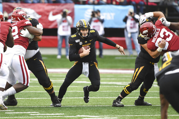 Missouri quarterback Connor Bazelak carries the ball against Arkansas during the first half of an NCAA college football game Friday, Nov. 29, 2019, in Little Rock, Ark. (AP Photo/Michael Woods)