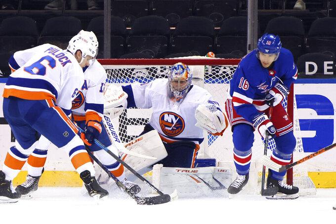 New York Islanders' Semyon Varlamov (40) defends the net against New York Rangers'Ryan Strome (16) during the first period of an NHL hockey game Thursday, April 29, 2021, in New York. (Bruce Bennett/Pool Photo via AP)