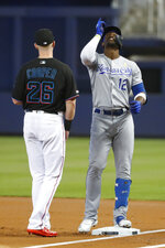 Kansas City Royals' Jorge Soler (12) celebrates after getting a single as Miami Marlins first baseman Garrett Cooper (26) looks on during the first inning of a baseball game Saturday, Sept. 7, 2019, in Miami. (AP Photo/Wilfredo Lee)