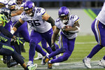 Minnesota Vikings' Dalvin Cook (33) rushes against the Seattle Seahawks during the first half of an NFL football game, Sunday, Oct. 11, 2020, in Seattle. (AP Photo/John Froschauer)