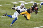 Pittsburgh Steelers wide receiver Diontae Johnson (18) makes a catch past Indianapolis Colts cornerback Rock Ya-Sin (26) for a touchdown during the second half of an NFL football game, Sunday, Dec. 27, 2020, in Pittsburgh. (AP Photo/Don Wright)