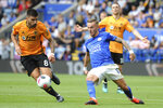 Leicester's James Maddison, right challenges for the ball with Wolverhampton Wanderers' Ruben Neves during the English Premier League soccer match between Leicester City and Wolverhampton Wanderers at the King Power Stadium in Leicester, England, Sunday, Aug.11, 2019. (AP Photo/Rui Vieira)