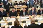 Russian Foreign Minister Sergey Lavrov, center, Defence Minister Sergei Shoigu, center left, talk with France Foreign Minister Jean-Yves Le Drian, back to the camera bottom right, and Defence Minister Florence Parly, back to the camera bottom left, during their meeting in Moscow, Russia, Monday, Sept. 9, 2019. (AP Photo/Pavel Golovkin)