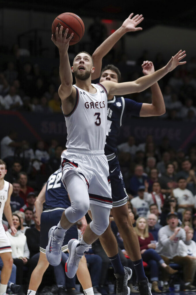 Saint Mary's guard Jordan Ford (3) shoots against Utah State forward Diogo Brito (24) during the first half of an NCAA college basketball game in Moraga, Calif., Friday, Nov. 29, 2019. (AP Photo/Jed Jacobsohn)
